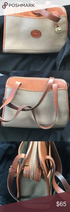 Dooney & Bourke Purse Pre owned condition with some dark areas on strap and on corners. The two outside pockets has some marks shown in pictures. Enjoy Dooney & Bourke Bags Shoulder Bags