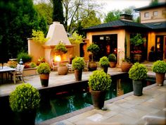 Pleasing Patio Designs: Boxwood planters surround the pool, fireplace and lounging areas on this patio, posted by Design by Rate My Space contributor  allende. From DIYnetwork.com