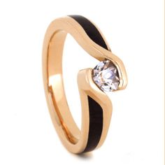The playfully designed wood engagement ring is designed with purple heart wood, for the perfect organic touch.  See more here: https://jewelrybyjohan.com/shop/wood-engagement-ring-14k-rg-2903/