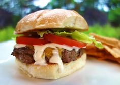 Buffalo Burgers 1 lb hamburger 1/4 cup wing sauce 1 (1oz) packet Ranch dressing mix 3 cheddar cheese slices 3 Tbsp Ranch dressing 3 hamburger buns, toasted