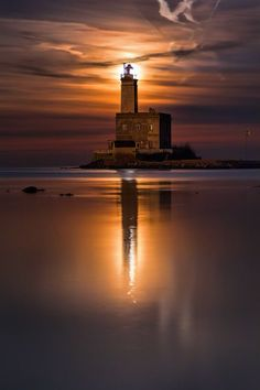 The Moon Dawns Over The Lighthouse Of Olbia, Sardinia, Italy | Photo By Fabio Serra