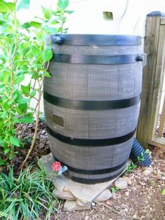 We love our rain barrel!  Sitting on natural stone rather than concrete blocks