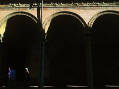 Twitter / @Budget Traveller: Under the arches, in the shadows... #blogville #Bologna