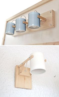 Design studio iLiui, have created this modern wall lamp that uses wood and matte painted recycled tin cans as part of the design. lamp These simple lamps use recycled tin cans as lamp shades Diy Wand, Diy Luz, Mur Diy, Recycled Tin Cans, Recycled Lamp, Deco Luminaire, Ideias Diy, Wooden Lamp, Room Lights