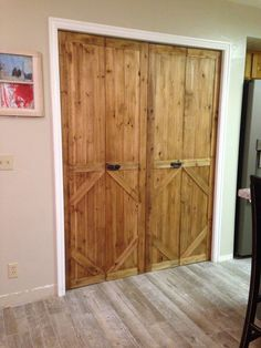 Old Bifold door made into barn door style. Cut to size place right over the top. 8-ft V-Groove Raw Cedar Wood.  Nail gun  wood glue bifold door.  Really fun to make