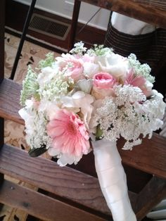 Hand-tied Bridal Bouquet of Pink Gerbera Daisies, Pink Cabbage Roses, White Hydrangeas, Queen Anne's Lace with Silver Dusty Miller Leaves.  Designed by Colonial Florist, Gordonsville, VA.
