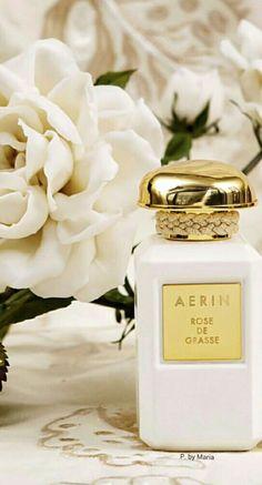 parfum femme aerin rose de grasse bouteille blanche bouchon dor