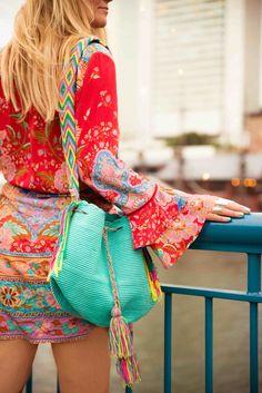 A girl and the city! Beautiful turquoise Wayuu bag