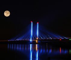 Rising moon over Indian River Inlet Bridge (located on Coastal Highway between Bethany Beach and Dewey Beach, Delaware). Taken by Maureen Ickrath/March, 2013. Entered in The Washington Post's 2013 travel photo contest.