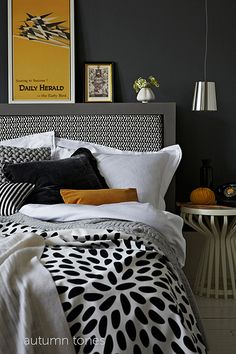 Wonderful mix of texture and patterns in a black/white/grey theme;  the pop of mustard pulls it together