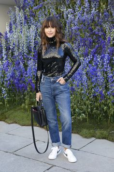 Miroslava Duma at Dior presentation in denim, a sequin top, and sneakers.
