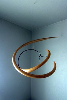 Wood and iron mobile ca. 1989 ..... Artist unknown - do you know who have created this beautiful cinetic art?