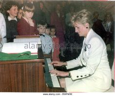 Prince And Diana Princess Of Wales Visit To Czechoslovakia May 1991 princess Diana Playing The Piano Note Perfect She Was Not - Stock Image