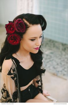 Bride getting ready | Deep red roses in her black hair | Photography: DNA Photographers | Hair: Merle Titus | Bridal Make-Up: Ashleigh McHaffie