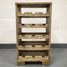 House your wine collection in style with this freestanding reclaimed wood wine rack. 15 bottle capacity.  Approximate dimensions; Height 75cm Width 40cm Depth 30cm  The wood is carefully hand-sanded multiple times to achieve a smooth touch whilst retaining its aged character and texture. All edges are gently rounded off. Available in a choice of stain colours. Finished with multiple coats of waterproof clear satin varnish.  Made to order.  ||||  Reclaimed wood has aged character and texture…