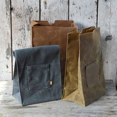 Upgrade his lunchbag - waxed canvas - Peg and Awl ( I own this and love it)