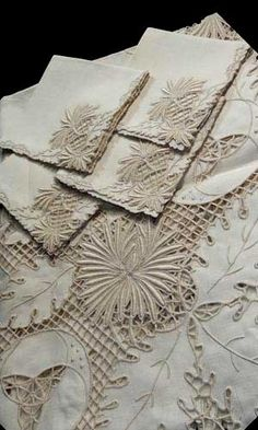 Vintage Italian linen and cutwork tablecloth and napkins.