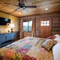 The Grizzly board lodge 130 features a home filled with warm brown colors thanks to the logs. It makes the interior and exterior of the area look and feel very cozy. Zion Mountain Ranch, Lodge Bedroom, Cedar Siding, Outdoor Areas, Lodges, Interior And Exterior, Rustic, Table, Bedrooms