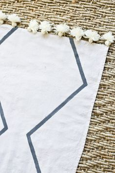 Learn how to make a West Elm inspired rug from a drop cloth with a few simple materials. With little money, you can quickly have your own custom version.