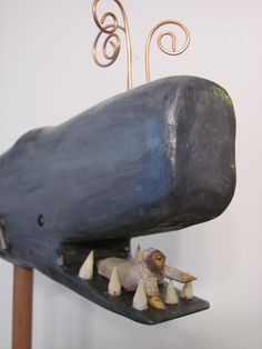 Jonah trying to get out of whale's mouth - handcarved