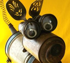 DIY Recycled Dog using cans, spoons, & springs. Would be cute in a garden, perhaps with a bit of color!