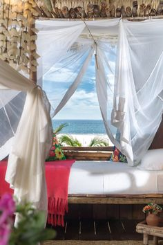 Gauzy canopies and floral print furnishings offset the rustic feel of the bungalows. #Jetsetter