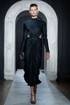 A blue black silk with center pinched and draped style with peekaboo skin sides but high neck makes an Eastern look with potential trashiness writ all over it sail smoothly into most gorgeous night.  Jason Wu Fall 2014 Ready-to-Wear Collection Slideshow on Style.com