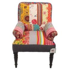 Add a splash of colour to your sitting or dining room with this cotton patchwork armchair, featuring piping detailing and wood turned legs. Team with mixed motif cushions and vibrant fabrics for an eclectic feel.    Product: ChairConstruction Material: Wooden legs, polyester filling and cotton upholsteryColour: MultiDimensions: 90 cm H x 66 cm W x 60 cm D
