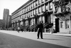Poet Langston Huges in the Middle of Harlem Street. 1957.