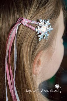 Snowflake Hair Clips in Pink, Silver, and White with Ribbon Streamers!  This set of 2 little snowflake snap hair clips are perfect for any girly girl in the winter. The ribbon streamers make them extra girly!  Made from snap clips wrapped in pink and white satin ribbon with just a little sparkle and topped with a puffy, silver, holographic snowflake! Ribbons extend about a foot at the end of the clip