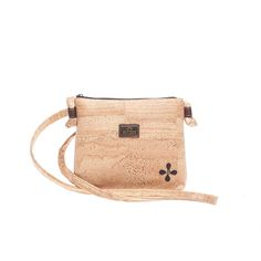 Small Vegan Cork Bag with flower detail, contrasting in color. Eco-friendly, durable and made in Portugal with Portuguese cork. Montado – Cork Fashion.