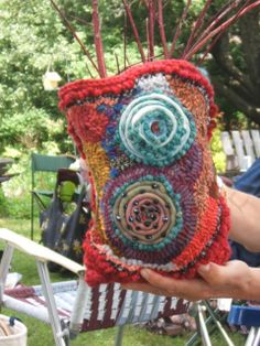 this 'container' was first crocheted, then the hooking was done into the crocheting and embellished with coiled wool, yarn & beads