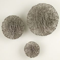 Intricately wrapped wire forms the Global Views Wired Wall Disc 's soothing disc shape. This wall sculpture features a gleaming metallic finish. Dining Room Sideboard, Entryway Console, Wall Accessories, Decorative Accessories, Accessories Online, All Wall, Wall Décor, Tuscan Decorating, 3d Wall Art