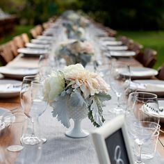 Milk Glass goblets for centerpieces.  Love the frosty leaves of the dusty miller