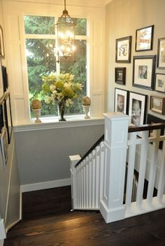 I love the floors, the moulding and the collection of frames