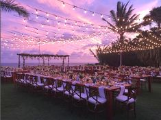 A beautiful sunset at this wedding ceremony at The Ungasan. #Bali Our teak parsons tables and teak cross back chairs.  #Furniture #rental #RevelRevelBali