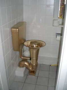 Tuba toilet - can you imagine the echoes? Pinterest home decor fail!