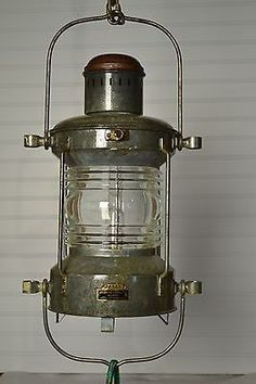 "This very nice galvanized oil burning light that was made by ""Ahlemann and Schlatter Beman"" from Germany. This is a Anchor light which is a white light with a horizontal arc of 360 degrees. The main h"
