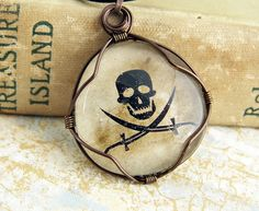 wired wrapped jewelry on cord   wire wrapped jolly roger glass cabochon pirate jewelry skull jewelry ...