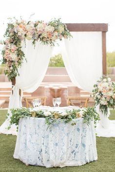Use the wedding arch as your wedding statement. Design the wedding arch with roses and white draping. To make your sweetheart table looks elegant, cover the table with patterned fabric. Floral Wedding, Wedding Colors, Wedding Flowers, Trendy Wedding, Boho Wedding, Spring Wedding, Blush Wedding Centerpieces, Wedding Decorations, Amy And Jordan