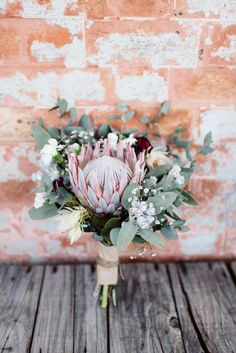 King Protea Blushing Brides make up this inspiring and beautiful bouquet. Inspiration for wedding flowers. Proteas are a great flower to include in your bridal bouquet and centerpieces. Small Wedding Bouquets, Navy Wedding Flowers, Bride Bouquets, Bridal Flowers, Bridesmaid Bouquet, Floral Wedding, Boho Wedding, Wedding Ideas, Bouquet De Protea
