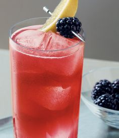 The GREY GOOSE® OAKS LILY™, served at the 139th Kentucky Derby: Combine 1½ parts GREY GOOSE Vodka, 3 parts Cranberry Juice and ½ part lime juice into a tall glass filled with ice. Present with a fresh blackberry and a slice of lemon.