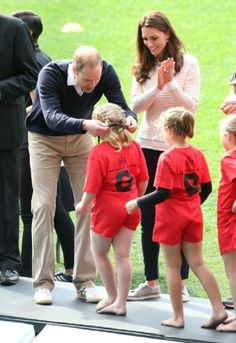 Prince William, Duke of Cambridge and Catherine, Duchess of Cambridge give out medals at the Rippa Rugby tournament at Forsyth Barr Stadium,13.04.14 in Dunedin, NZ