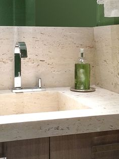 The goal of the project was to create a lightweight architecture and relaxing environment. The tone of wood, natural material chosen as the predominant one, decided all the colours of the apartment, with shades of beige to white, aiming to create this luminosity and tranquility mood. marble green bathroom