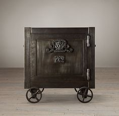"""Restoration Hardware  19TH C. MERCANTILE IRON SAFE SIDE TABLE  $1495   Special $1270  We've reproduced the compact, foursquare form and functionality of a 19th-century Victorian safe, crafted from iron just like the original. Embellished with an heraldic eagle and unfurling banners, the door opens to a roomy cabinet, while a key lock secures belongings. Also functions well as a side table.   DIMENSIONS 24½""""W x 20¾""""D x 27½""""H Weight: 158.4 lbs."""