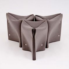 An investigation in structural folding, Felt Stool is comprised primarily of a sheet of felt, folded and riveted to simultaneously create structural volume and upholstery. In the spirit of origami, a series of folding patterns were developed, each starting with a single sheet of industrial felt. As the exploration evolved, the pattern was refined to efficiently use material and create a comfortable, saddle-shaped seat. The resulting Felt Stool is available here, and a part of the Museum of…