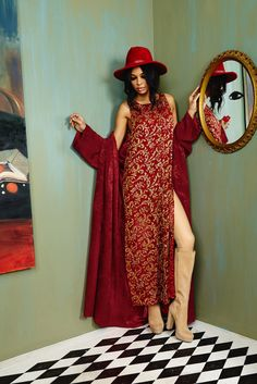 Love this red maxi with gold beads & nothing is sexier than a slit. Kimono's over everything for fall. Can't stop won't stop wearing our camel knee highs and topping things off with a red hat. #aofall16