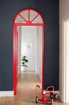 Having a red door has become a family tradition. The charcoal paint is Silk Aluminium from Plascon.