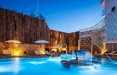 Hard Rock Hotel Ibiza is the first Hard Rock Hotel in Europe. A luxury resort with rooms and suites facing the sea and the biggest Spa on the island of Ibiza. Hard Rock Hotel Ibiza, Ibiza Hotel, Outdoor Spa, Outdoor Decor, Playa Den Bossa, Dream Pools, Spring Nature, Looks Cool, Houses