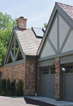 """Addition/renovation of 1930's tudor home. Family room, exercise room, """"spa"""" room & 2 car garage. Chicago common brick, painted cedar, stucco & wood shake roof to match original house. North elevation drive-way & side entry to addition/renovation."""
